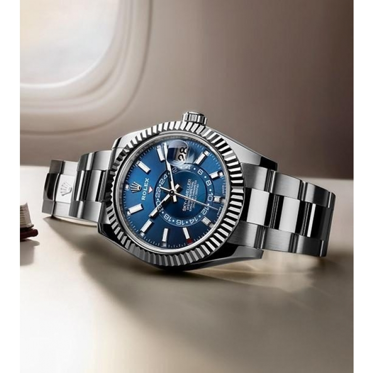 Rolex The Oyster Perpetual Sky-Dweller in White Rolesor with a bright blue dial and an Oyster bracelet. RLX Sky-Dweller